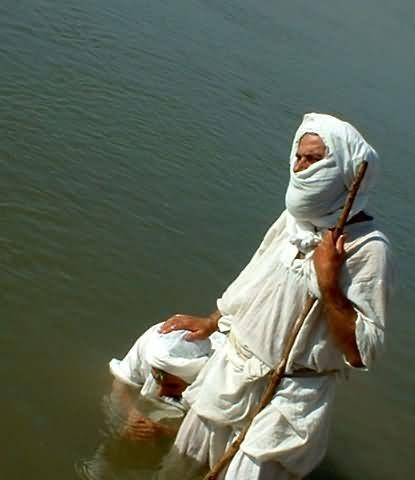 First-priest-baptizing-his-apprentice.jpg