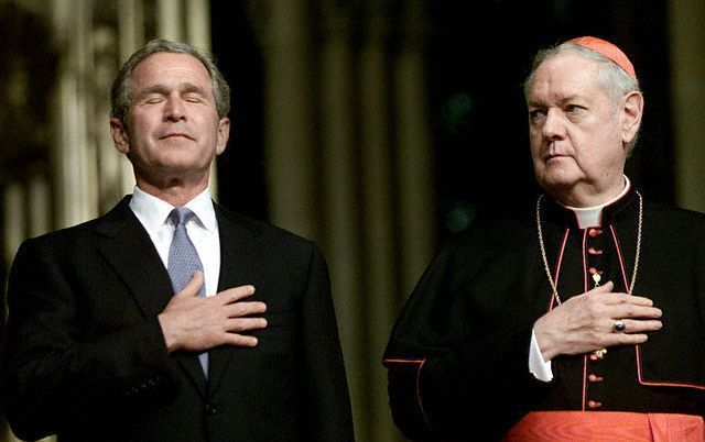 BUSH PUTS HIS HAND TO HIS HEART AT ST. PATRICK'S CATHEDRAL